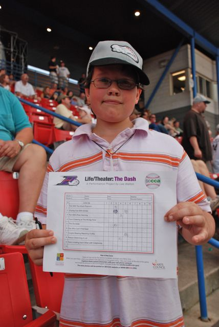 Fan with FIlled out Scorecard