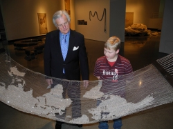SECCA Foundation Board member Gordon Peterson tours Vibha Galhotra's Metropia exhibition with his Little Brother Aidan.